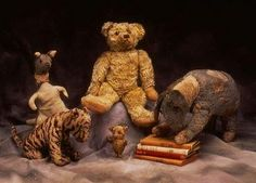 The REAL Winnie-the-Pooh, plus Tigger, Kanga, Piglet, and Eeyore. They now live at the New York Public Library. I hope to see them some day!