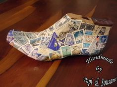 An old original wooden shoe last is covered with vintage postage stamps  choosen and placed carefully on it.    It is varnished and shined.    A jewel to decorate your wall or your library, coffee table, or even your office.    $65