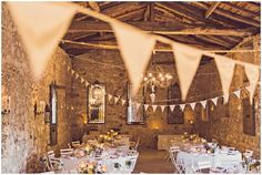 Wedding barn decorations | Image by Claire Penn Photography