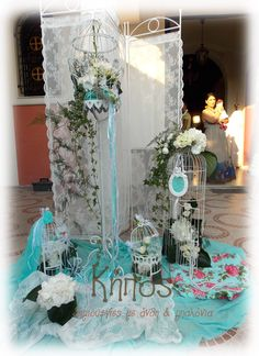 Vintage romantic tiffany blue wedding and baptism decoration , using cages , birdcages, pearls, floral , flower arrangement , lace , pink , tin , white hydrangea .