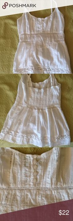 American Rag Cie camisole top Light as a summer breeze. Gorgeous boho Cami with solo many details. Ruched back adjustable straps, pricing, pintucks, and lace. Buttons center front. Festival time!  Great condition. American Rag Cie Tops
