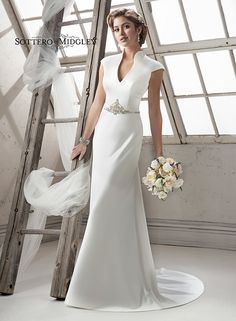 Dramatic satin sheath wedding gown, Constance by Sottero and Midgley, complete with mandarin collar and sexy keyhole back.