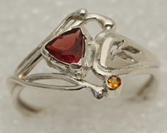 Custom, one of a kind sterling silver ring with garnet and citrine.