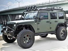 army green jeep.- something bout them makes them well cool or whatever other word works