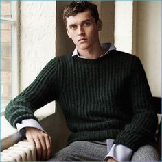 Anders Hayward wears a hunter green sweater with darted trousers from Zara Man.