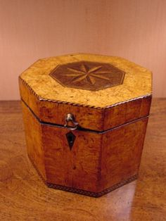 "A rare 18th century large   octagonal-shaped burr elm tea caddy with inlaid patera and signs of foil lining.  The caddy opens on double brass hinges. England, circa 1780, 6""H, 7.5""W, 7.25""D from Charlecote Fine Antique Furniture & Objets d'Art"