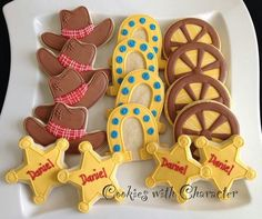 Cowboy hats, badge, wagon wheel and horse shoe cookie