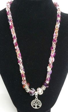 Tree of Life pendant on a hand-knitted cord!  Toggle closure, premium glass bead accents, and metal bead accents.!
