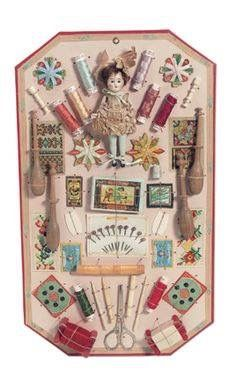 """French,circa 1910, 10"""" x 17"""" card. A heavy cardboard presentation card with rose paper backing and decorative borders is fitted with an assortment of sewing materials and tools including threads,sample cards,bone tools,scissors,pins,and more,along with an all-bisque doll with glass eyes and mohair wig,silk dress and high blue painted stockings,presumably the doll for which a trousseau would be made. For Parisian Au Louvre department store,the card of rose-tipped pins is labeled """"Louvre""""."""