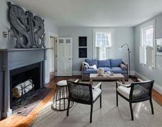 light gray-blue living room, metal art above fireplace (Sherwin Williams, Upward)