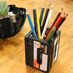 Make an upcycled pencil holder using 4 upcycled cassettes. Tape cassettes are readily available and make for funky stationary holders.