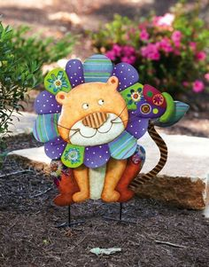 """Wild Garden Lion Yard Stake by Accent Your Life. $44.99. Hand painted. Made of metal. Easily stakes into the ground. Approximate dimensions are 20"""" x 1"""" x 25"""". Great for yourself or as a gift. This hand painted metal lion garden stake adds a bit of playful decoration to any outdoor space."""
