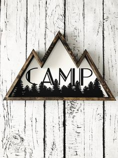 """This mountain shaped wooden sign with the word """"camp"""" completes any adventure theme you have going on or would make the perfect gift for any campers dream space - 22"""" along the bottom - painted with c"""