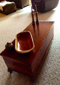 Beautiful cedar chest used as a coffee table and to display 125 year old bread bowl and butter mold.