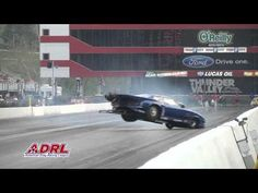 Drag racer Lizzy Musi's car spins out of control and goes airborne and takes out the camera....