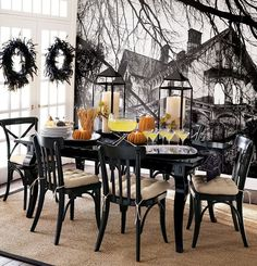 Using white dishes, silver platters, black tablecloth, orange pumpkins...white, glass, silver