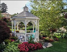 Beautiful gazebo with colorful landscaping.