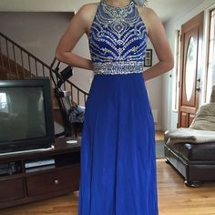 Prom dress Beautiful Royal blue prom dress only worn once, looks brand new with beautiful rainbow sequins on the front and back of the chest piece. Clasps on shoulder straps for easy changing. Chest is 30in and waist is 27in, length is 60 in. Offers wanted as I am negotiable Dresses Prom