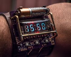 Engineer designs a cyberpunk themed wristwatch using a VFD display tube powered by a single AA battery. Unfortunately, it only runs for a few hours.