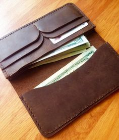 High quality, handcrafted unisex wallet made from genuine leather. Genuine leather makes it long lasting and you will be pleased by it's quality and beautiful simple design.  Long wallet consists of 3 cash compartments and 4 compartments for cards. It doesn't closes with zipper or buttons, so you can have easy and fast access for your money. This item can become a wonderful gift for your partner, dad, friend or colleague. Dimensions: Length: 20.2 cm. (8 in.) Width: 10 cm. (4.05 in.)