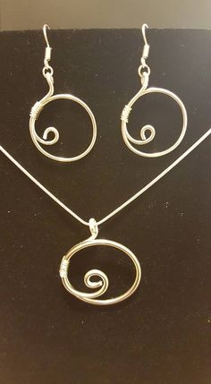 silver aluminum swirl earrings and necklace on sterling silver chain