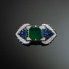 Cartier brooch set with emeralds sapphires and diamonds 1922
