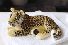 I am especially proud of the sugarpaste leopard I made to go on top of a cake. No moulds used, and I painted the spots on by hand.