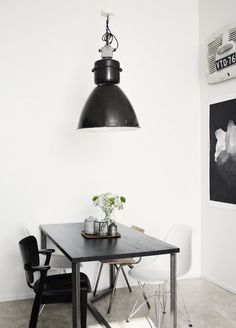 dat achterklepje van Fiat 500 :)) chairs lamp white walls table great looking dining space industrial home decor interior.