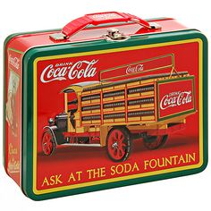 Coke Embossed Large Lunch Box Soda Fountain, Carry your lunch in style... in a sturdy embossed-metal lunch box. Reminiscent of lunch boxes of old, this roomy container with secure metal latch can handle the heartiest lunch.