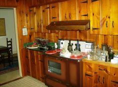 Cape Cod Knotty Pine Kitchen, small kitchen, side breakfast nook and reading room (or din if you like), Kitchen area, stove , Kitchens Desi.. Knotty Pine on walls in kitchen. so don't have to take down for dining room to kitchen remodel..