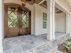 front porch ideas curb appeal Flagstone porch and beautiful doors by Horizon Custom Builders stained in Minwax Jacobean Porch Flooring, Stone Flooring, House With Porch, House Front, Flagstone Walkway, Front Walkway Landscaping, Walkway Ideas, Walkways, Porch Ideas