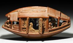 Chinese Olive Pit Carving ----  carving of a boat by Chinese artist Ch'en Tsu-chang, who lived in the 18th century. This is a 1.5″-long olive pit!