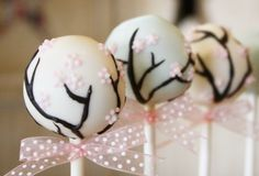 Gorgeous cake pops decorated with cherry blossoms!!