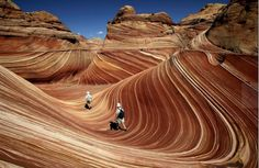 "The Wave, Arizona ( Spencer Weiner / Los Angeles Times ) ""Weird, dreamlike world of swirling colors and psychedelic patterns ... looked like gooey taffy, stretched over huge mounds and 50-foot canyon walls. The Wave is like an enormous Olympic-size swimming pool, with swooning, undulating walls lined with burnt sienna, pink, gray, turquoise and pale green. The bands mostly run horizontally, but at spots they zigzag and shimmy before falling back into their previous pattern."""