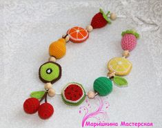teething necklace baby teether baby teething toy nursing necklace breastfeeding necklace crochet beads toddler gift crochet fruit eco toy  Colorful and tasty necklace! Orange, lemon ,kiwi, wagon, - soft and rustling Strawberry,raspberry - soft Pear, apple, cherry - firm  Length