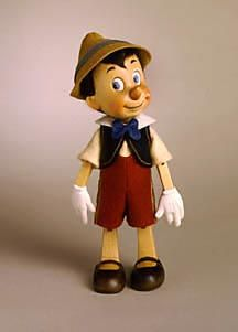 "RJW Dolls - Pinocchio 9"" hand carved Alpine maple, fully jointed. Date of Release: 1992 Ltd. Ed. 500."