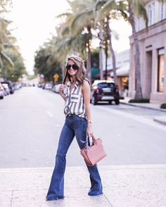Striped tank + flared jeans                                                                                                                                                     More