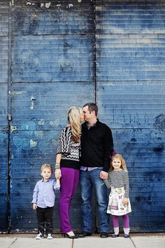 50 Beautiful Family Photo Ideas - love her colored pants that matches her husbands purple under shirt and the kids! However, I like nearly every single image on this list!