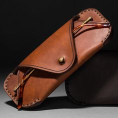 MAKR  Eyewear Sleeve  $90.00  While we can debate forever the various merits between Persol, Oliver Peoples, and Tom Fords' frames, Makr closes the argument on how you should carry them with their beautiful hand sewn leather sleeve. Sunglass or eyeglass it will continue your classic look.