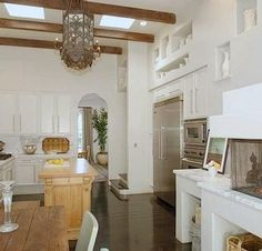 kitchens - white spanish revival high ceiling fireplace  Selma Ave, Hollywood Hills, May 09  white cabinets, rustic wood dining table, spanish,