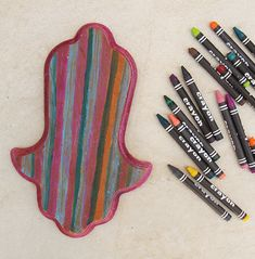 Melted crayon on wood hamsa craft.