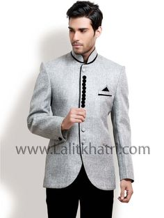 Unique look grey color #Jodhpuri suit is fashioned on jute fabric and paired with black #Trouser. Item code : TSJL1139 http://www.lalitkhatri.com/label/men/mens-designer-suits.html