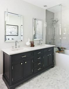 gray hex floor tiles paired with gray subway tile in the shower and dark vanity