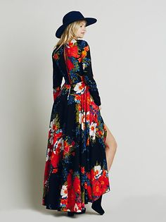 First Kiss Dress   Long-sleeved floral printed maxi. Button back closure and keyhole opening at top of back. Skirt portion is lined.