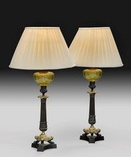 A pair of Regency bronze and ormolu lamps.
