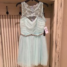 Prom Dress 11! My Michelle prom dress size 11! This dress was purchased at Dillards. It is NWT! Light mint green with a beautiful beaded ribbon belt! Gorgeous dress! Make me on offer! My Michelle Dresses Prom