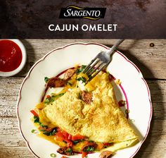 Get all the cheesy omelet goodness you want with less than 250 calories per serving. This easy Cajun-inspired omelet combines the full Cheddar flavor of our Ultra Thin Cheese Slices with spicy andouille sausage, peppers and spinach. Get the full breakfast or brunch recipe on Sargento.com.