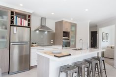 On trend dual tone kitchen cabinetry  with different textures. Interesting colour and material combinations using wood stains, paint and laminate offer refreshing ways to add interest in your home's loved space. #ourstories #clientreferences #kitchen #galleykitchen #newhome #interiordesign #house #generationhomesnz