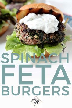 Fire up the grill and cook your people these juicy Spinach and Feta Burgers, topped with tzatziki sauce. | Greek Burgers | Greek Feta Burgers | Spinach Feta Burgers | Unique Burgers | Beef Burgers | Grilling | Summer Grilling | Labor Day Entree | Memorial Day Entree | July 4 Entree | Summer Burger | Easy Entertaining | #grilling | #cookout | #backyardbarbecue |#speckledpalate