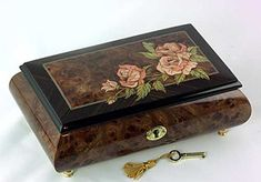 Beautiful inlaid pink roses set off to the side in burl elm with exotic dark rosewood border.
